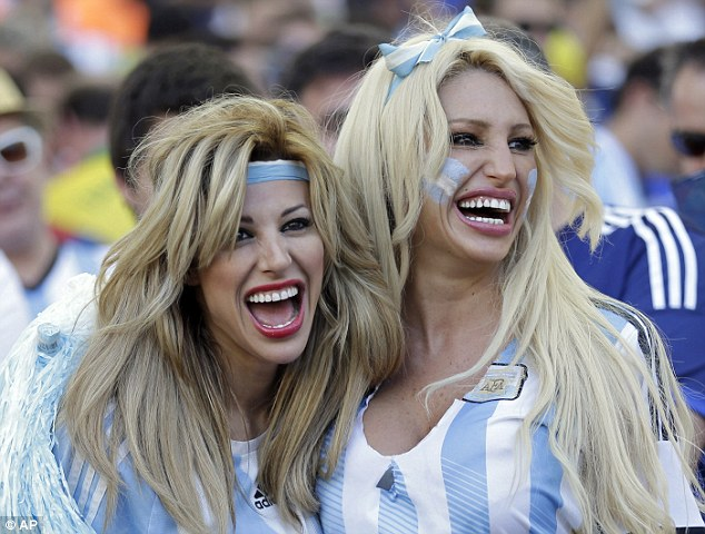 Sitting pretty: Argentina supporters pose in the Maracana before the World Cup final