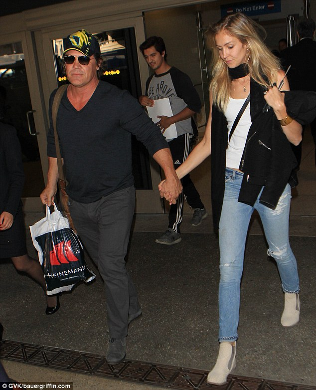 Laid-back: Josh looked casual in a V-neck, grey trousers, and suede shoes as he was joined by Kathryn earlier this week at LAX following a visit to the Venice Film Festival in Italy