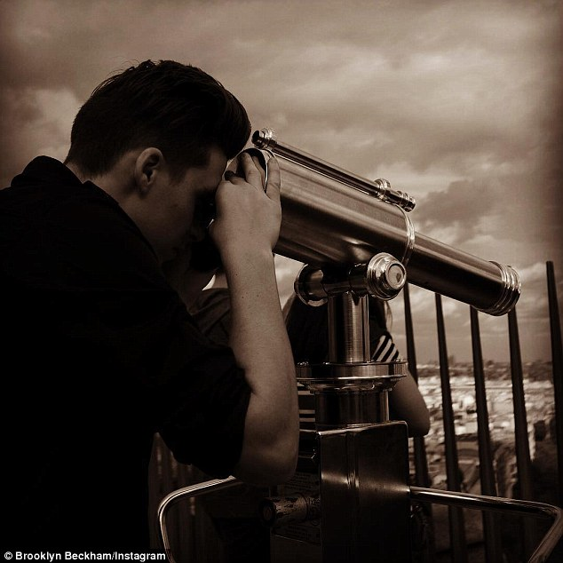 Arty: Brooklyn shared this snapshot of him looking over the city from the top of theEiffel Tower on his Instagram page