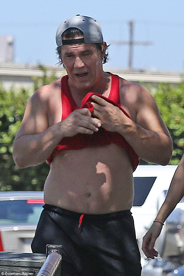 Coordinating: The star sported a red tank top to visit Gold's Gym in Venice, California, which he coupled with a pair of black and red athletic shorts