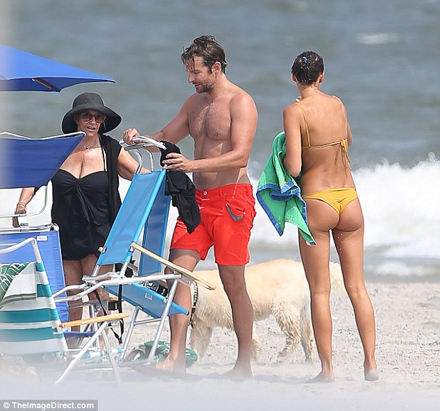 It's a family affair: The couple were joined by Bradley's mother Gloria for their day at the beach