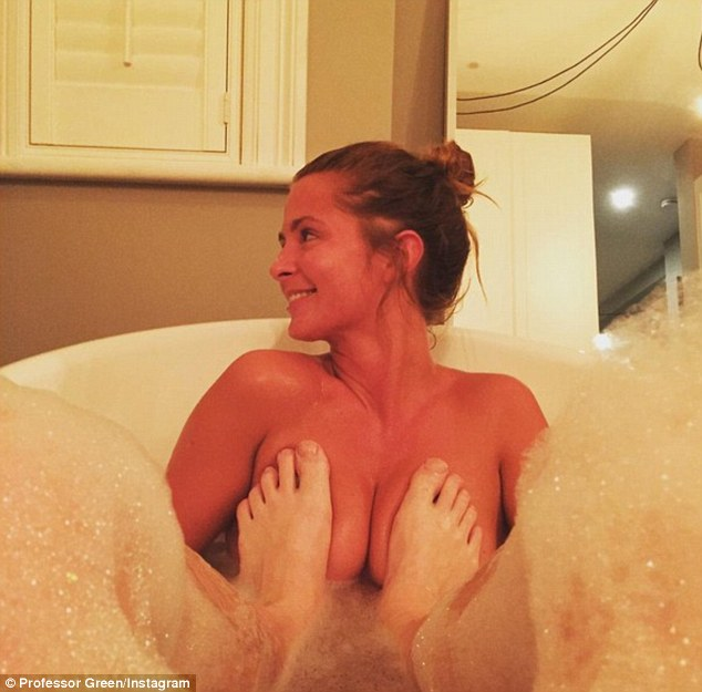 Raunchy: Professor Green, 31, has proved that his marriage to Millie Mackintosh, 26, is very much still on track after he posted a photo of them naked in a bath together on Sunday evening