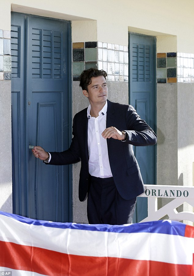 Door man: He unveiled their version of a Walk of Fame star - a beach locker room dedicated to him - on the Promenade des Planches in the sea-side resort