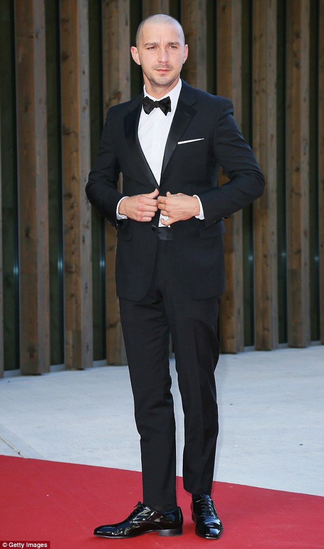 Suits you: Shia was a far cry from his scruffy self when he attended the Man Down premiere at the Venice Film Festival in Italy on Sunday