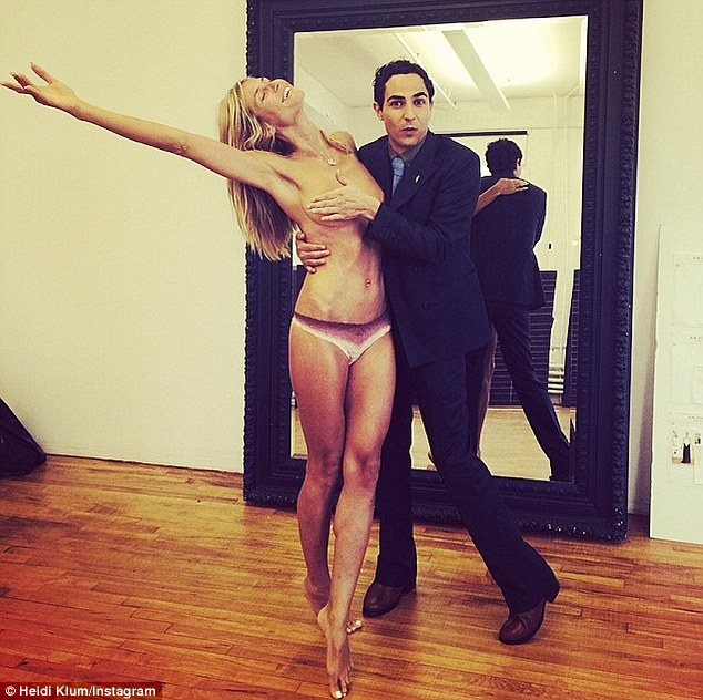 Exhibitionist: The 42-year-old mother-of-four frequently shares her scantily clad 5ft9in figure with her captive, combined 9.1M followers on social media (pictured with Zac Posen)