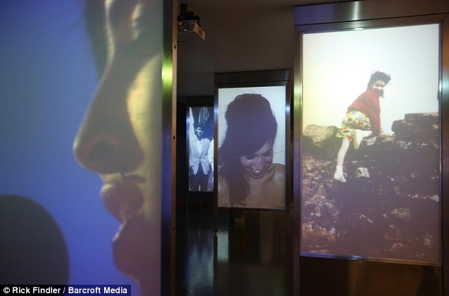 Through the years: Digitally projected images of Amy Winehouse hang in the entrance to the exhibit