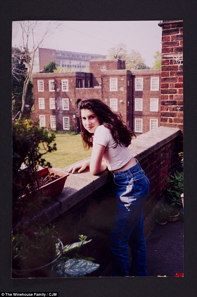 Amy Winehouse: A Family Portrait was curated by the Jewish Museum of London with the assistance of the her brother Alex and sister-in-law Riva. A young Amy is seen here outside her grandmother's house