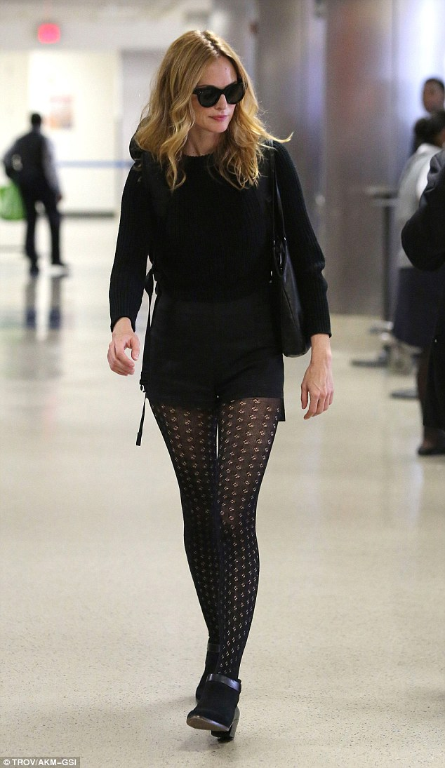 Amazing pins: The 47-year-old looked stunning in patterned tights and ankle boots