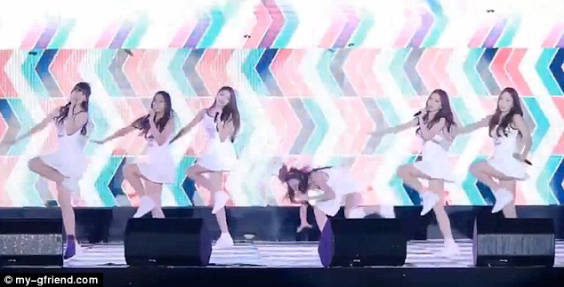 The girls showed unwavering determination to keep to their dance routine, when the slippery floor of the stage sent singer SuniB (third from the right) plummeting to the ground first