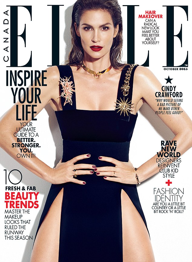Brunette bombshell: Cindy graced the cover of Elle Magazine for their October issue in a navy leg-baring design while sporting a crimson lip color and a gold choker
