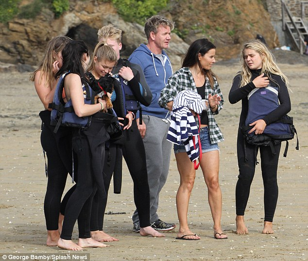 Family time: Gordon and Tana were joined by their four children and a friend on the sand as they spent a relaxing day together, near the Ramsays' new home in Rock