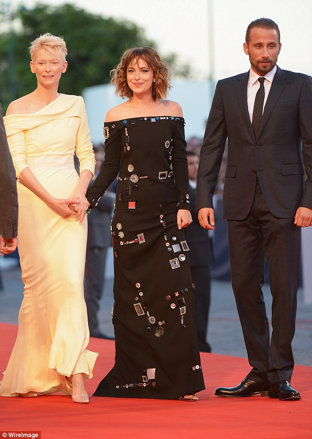 Stylish group: Dakota looked a knockout in her black dress, but had stiff competition from Tilda in her lemon gown, and a very sharply-dressed Matthias
