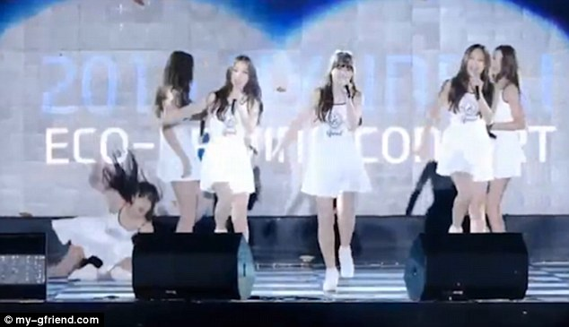 The stage had been rained on before the girls had gone on, making it difficult to dance without falling down