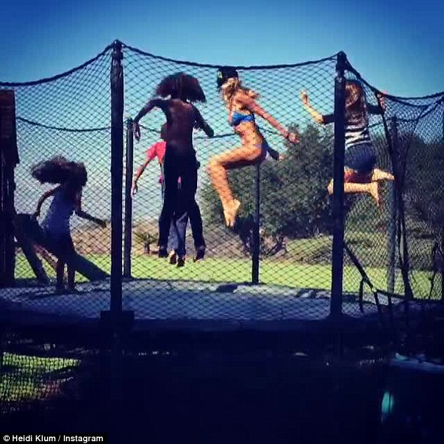 Bouncing with her babies! On Saturday, the evergreen model posted a video of her bikini-clad self jumping on a trampoline with her children - Leni, 11, Henry, 9, Johan, 8, and Lou, 5
