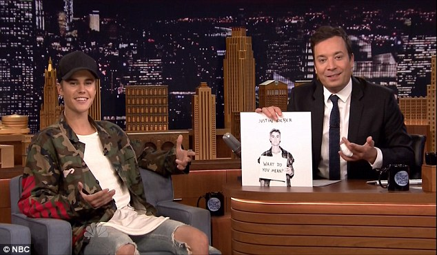 In the spotlight again: The Canadian singer has been doing the rounds of the TV talk shows to publicize his single. He's pictured with Tonight Show host Jimmy Fallon on Wednesday