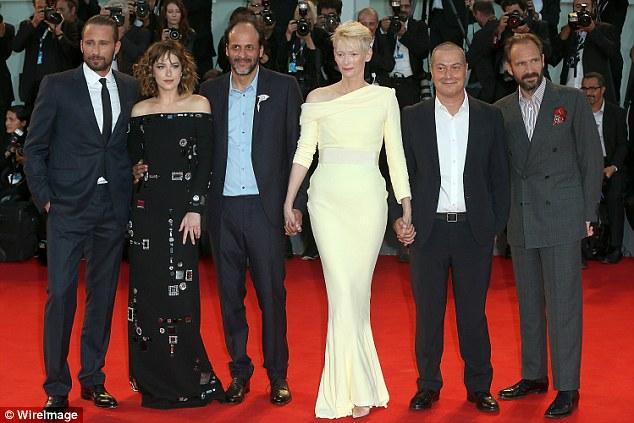 Altogether now: (L-R)Matthias Schoenaerts, Dakota Johnson, director LucaGuadagnino, Tilda Swinton,Corrado Guzzanti and Ralph Fiennes posed as a group for the A Bigger Splash premiere