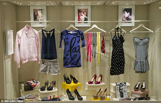 Style: Swinging from a rack are a collection of Amy's outfits, including her favourite dresses and more casual clothes