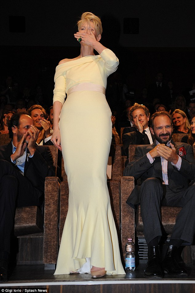Her moment: Tilda received a round of applause from the audience as she stood up to blow kisses