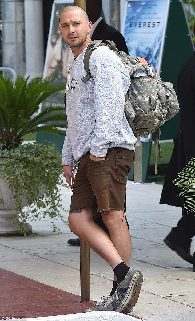 Cool and casual: ShiaLaBeouf ditched his tuxedo and slipped into a more comfortable outfit for a day of sight-seeing in Venice on Monday