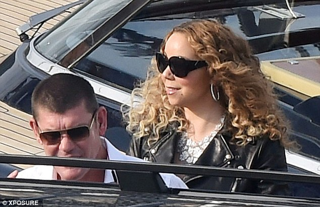 Low-key glamour: Mariah wore a black leather biker jacket which she teamed with a black strapless maxi dress and a white decorative necklace