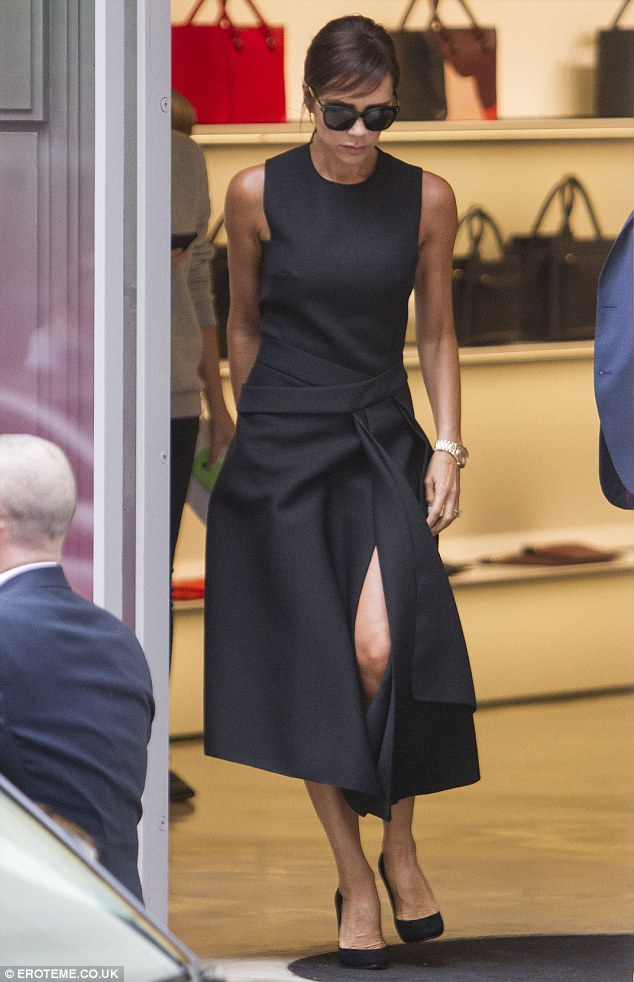 Walking clotheshorse:Victoria, 41, was a vision of minimalist style as she was photographed tottering around the capital in a pair of sky-high black court stilettos and the fashion-forward one-piece from her Autumn/Winter 15 line