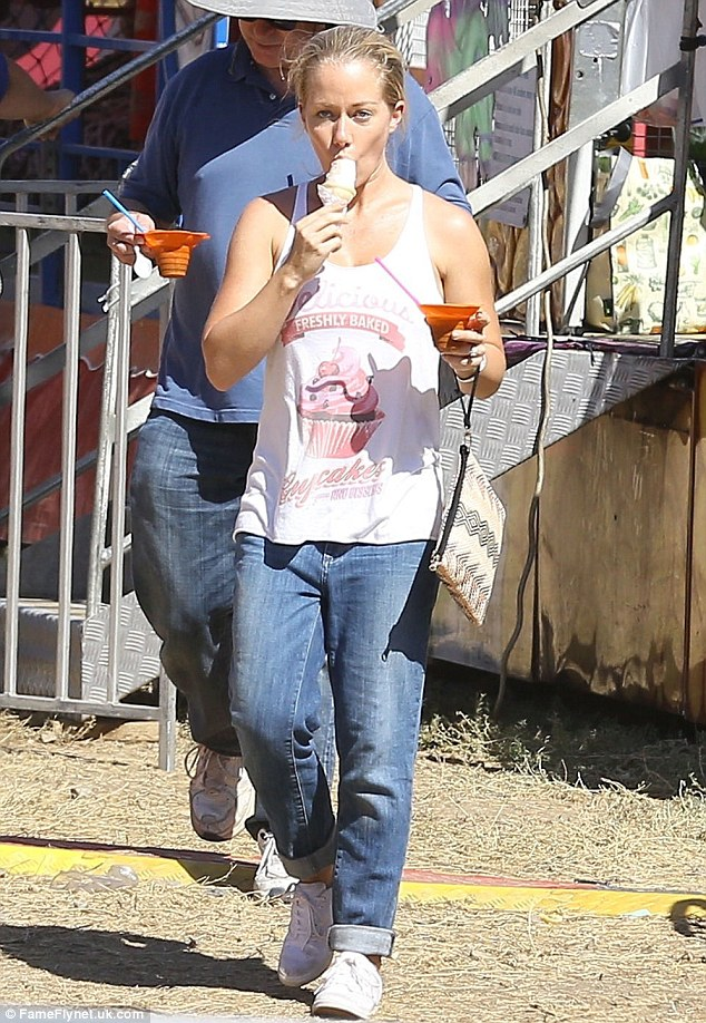 Summer treat: The reality star indulged in an ice cream cone after tackling the rides