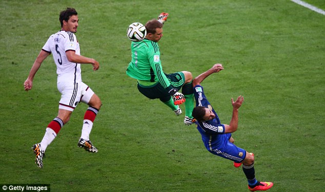 Collision: Manuel Neuer (centre) cleans out Gonzalo Higuain on the edge of the area after punching clear