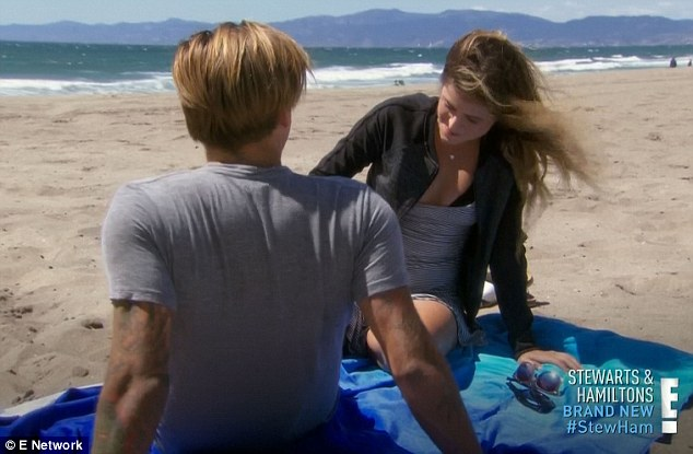 Bonding: He then bumbled with the surfboards and told her he's 'scared of sharks' before launching into chat about marriage and kids
