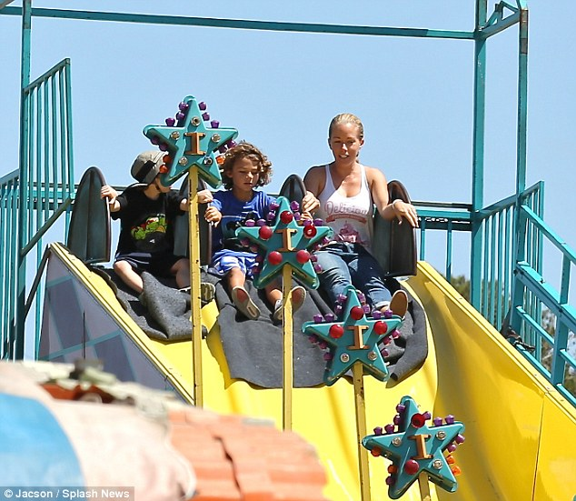 Fun times: Reality star Kendra Wilkinson joined her son Hank on the slide at the Malibu Fair on Sunday