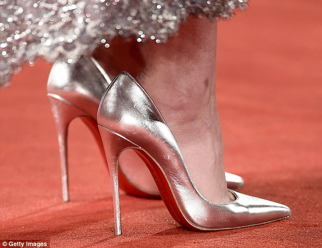 The Twilight star arrived at a screening of her new film Equals at the Venice Film Festival sporting a pair by French cobbler Christian Louboutin, only to kick off the sparkly clackers as soon as she'd taken her seat