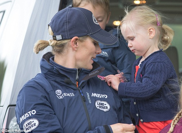 Two-year-old Matilda Wren (right) presented the Queen's granddaughter (left) with a sticker bearing the slogan 'Today I feel like a princess'