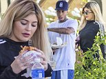 """**NO WEB, MUST CALL FOR PRICING** *EXCLUSIVE* Calabasas, CA - Voluptuous Kylie Jenner hits up her local Johnny Rockets, along with boyfriend Tyga, on a beautiful Labor Day Weekend.  The two appear to be in the mood for a juicy burger and fries as they ate al fresco on the patio.  The newly-blonde youngest member of the Kardashian/Jenner clan wore a pair of black leggings and Adidas long-sleeved shirt that showed off her curvy figure, while Tyga wore his usual casual get-up consisting of a white t-shirt, gym shorts, and sneakers. According to reports, Tyga is reportedly """"broke"""" and is reported to have leased Kylie Jenner's  white Lamborghini under her name. \nAKM-GSI       September 5, 2015\nTo License These Photos, Please Contact :\nSteve Ginsburg\n(310) 505-8447\n(323) 423-9397\nsteve@akmgsi.com\nsales@akmgsi.com\nor\nMaria Buda\n(917) 242-1505\nmbuda@akmgsi.com\nginsburgspalyinc@gmail.com"""