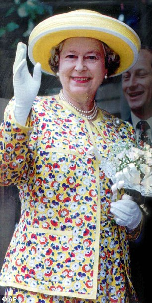 1990s: The Queen waves serenely during a Durban walkabout in a floral Hardy Amies suit and wide-brimmed hat