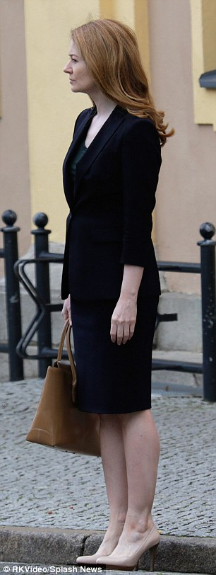 Back to work: Danes, 36, was seen sporting a brunette wig while Otto, 47, was all business in a skirt suit