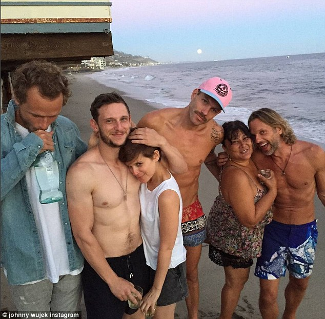 Clue: The day before, her stylist pal Johnny Wujek Instagrammed a photo of her resting her head against the Jamie's bare chest on the beach as they hung out with friends