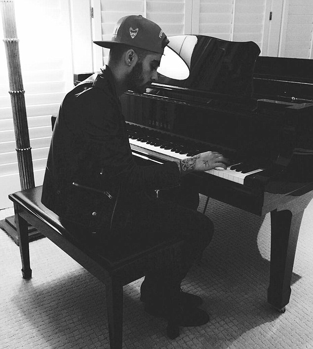 Skills on show: Zayn was pictured playing the piano in another artistic black and white snap
