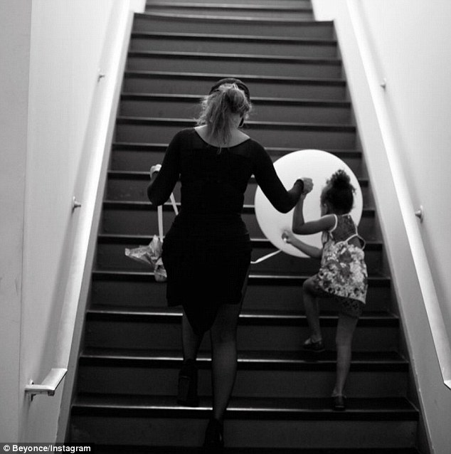 Little helper: Beyonce shared a series of touching snaps of daughter Blue Ivy helping her prepare for her concert