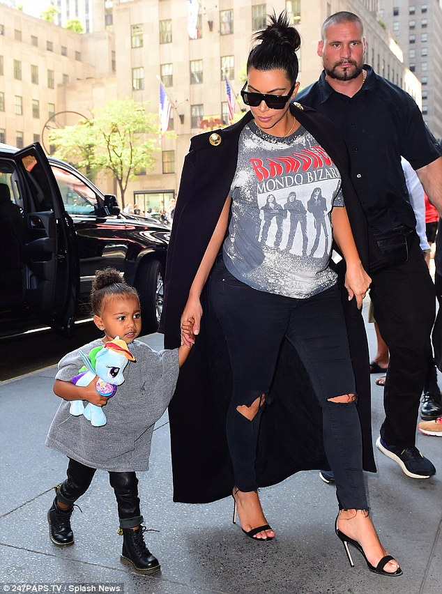 Mommy and me: The pair visit a friend of Kim's after their shopping spree