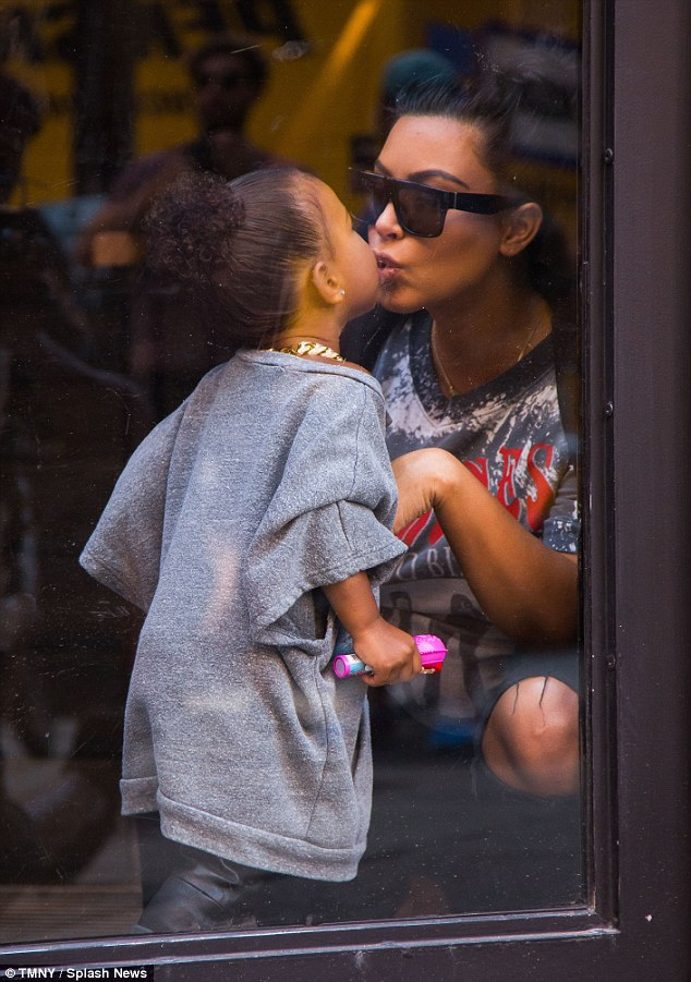 Pucker up: Kim and North shared a tender kiss while out in Manhattan