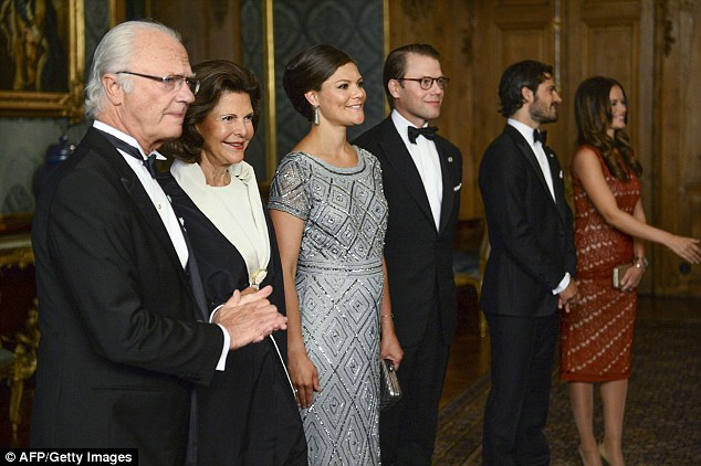 Happy news: The princess was glowing during the Sweden dinner at the Royal Palace in Stockholm. From left: King Carl XVI Gustaf, Queen Silvia, Crown Princess Victoria, Prince Daniel, Prince Carl-Philip, Princess Sofia
