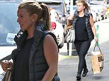 Picture Shows: Coleen Rooney  September 07, 2015\n \n Pregnant Coleen Rooney, wife of footballer Wayne Rooney, is spotted out shopping and chatting to a friend in Wilmslow, Manchester.\n \n Coleen, who is already a mother to her two sons Kai and Klay, dressed her blossoming baby bump in a black top worn under a sleeveless puffy jacket, along with black leggings and black trainers.\n \n Non Exclusive\n WORLDWIDE RIGHTS\n \n Pictures by : FameFlynet UK © 2015\n Tel : +44 (0)20 3551 5049\n Email : info@fameflynet.uk.com