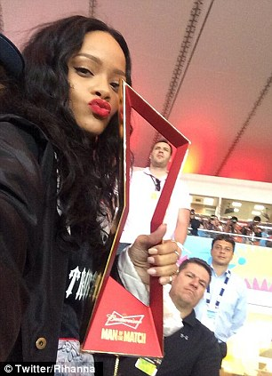 Woman of the match: Rihanna poses with the Man of the Match trophy