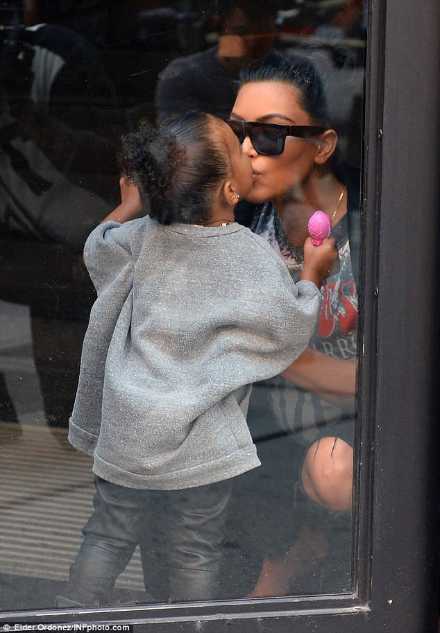 Sweet moment: Tiny North leaned and gave her mom a big kiss on the lips