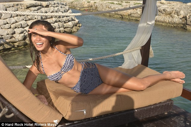 Hot actress: Jamie seemed happy to show off her toned beach body in a blue-and-white bikini