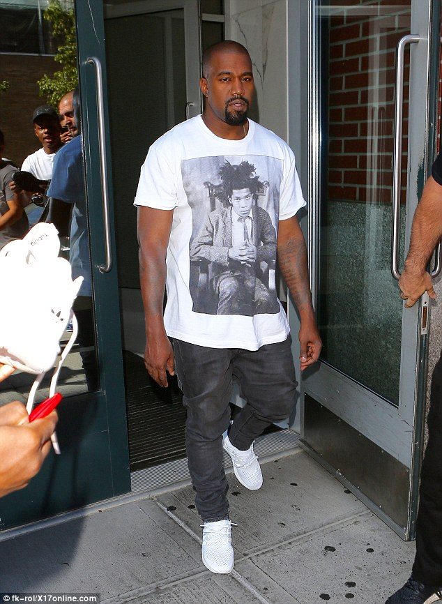 Going solo: Kanye left his NYC apartment without wife Kim Kardashian and daughter North - who were no doubt enjoying a lazy Labor Day Monday