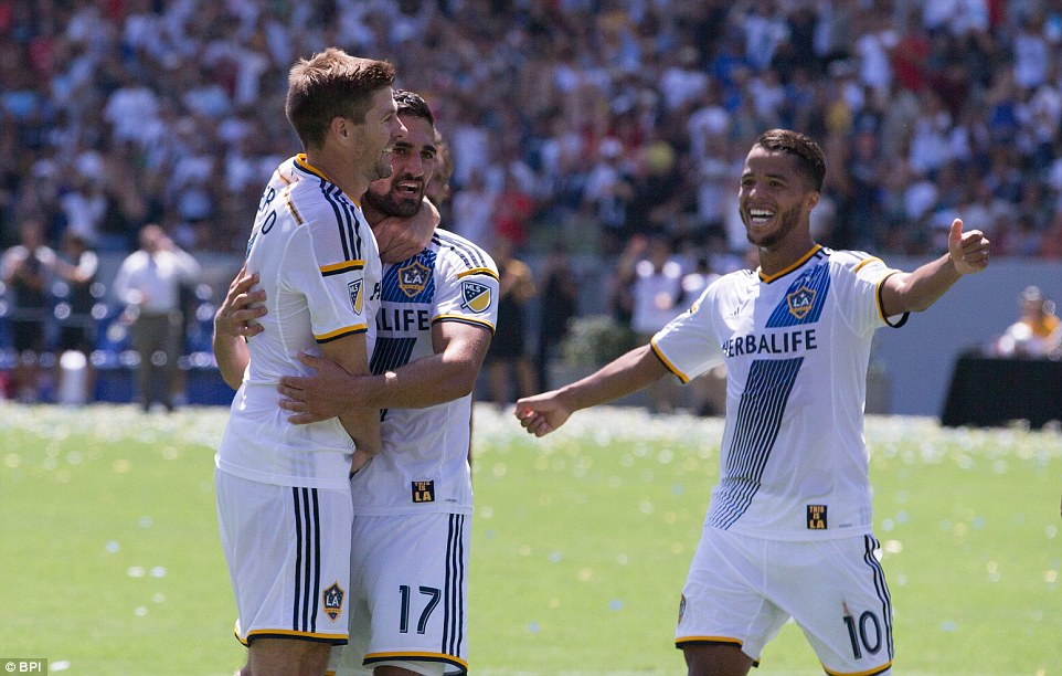 Gerrard celebrates with Sebastian Lletget (2nd left) after his drive deflected off his team-mate for the Galaxy's fourth goal