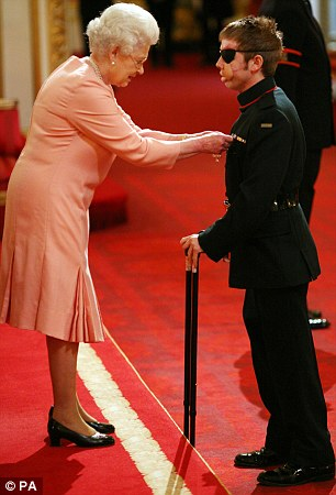 Proud moment: Corporal Ricky Furgusson, The Rifles, is decorated with the Military Cross, for services in Afghanistan, by Queen Elizabeth II