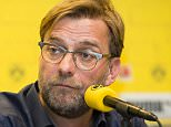 "Football manager Jurgen Klopp of Dortmund attends a press conference at Signal Iduna Park in Dortmund, Germany on April 15, 2015.     ""Please note this image forms part of the Getty Premium Access agreement and may incur an additional fee. If reused it must be downloaded from the Getty site""    DORTMUND, GERMANY - APRIL 15, 2015 (Photo by Alexandre Simoes/Borussia Dortmund/Getty Images)"