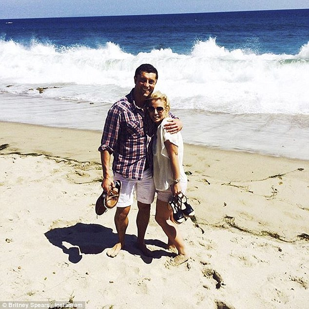 Handsome pal: Earlier this week Britney posted a snap of herself at the beach with a male friend