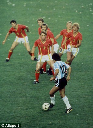 Legend: Diego Maradona takes on Belgium defenders at the 1982 World Cup